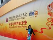 Ms. R. Gutman is by the entrance of the Olympic Village Conference Center, in Beijing, the venue that hosted the 29th World Conference of ISME, Aug, 2010