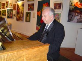 Edward Zon, pianist, performing at the New Year's Arts and Music Salon, benefit for CHARISMA Foundation, produced by !Class Act Productions