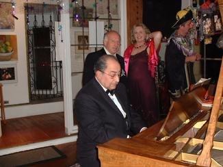 Arnold Kloian improvising on the piano at the New Year's Arts and Music Salon, benefit for CHARISMA Foundation, produced by !Class Act Productions