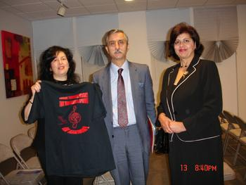 Ms. Rozalina Gutman presented  the advocacy message t-shirt, at the time of meeting with Mr. Joannis Andreades, Consul General of Greece and his wife, at the musical event, dedicated to the Holocaust in Saloniki, Foster City, JCC, 11.13.2010, discussing her upcoming project of Int'l Campaign for Music Education through Brain/Music Research at the upcoming 30th World Conference of ISME'2012, Thessaloniki, Greece, while enjoying very supportive remarks from them and the staff of the SF Greek Consulate.